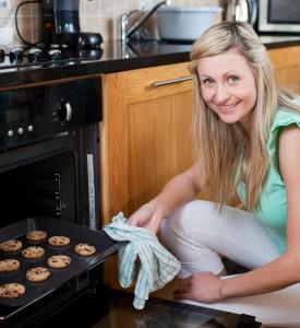 bigstock-Happy-Woman-Baking-Cookies-7419423