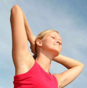 bigstock-Woman-Stretching-In-Sunlight-684603