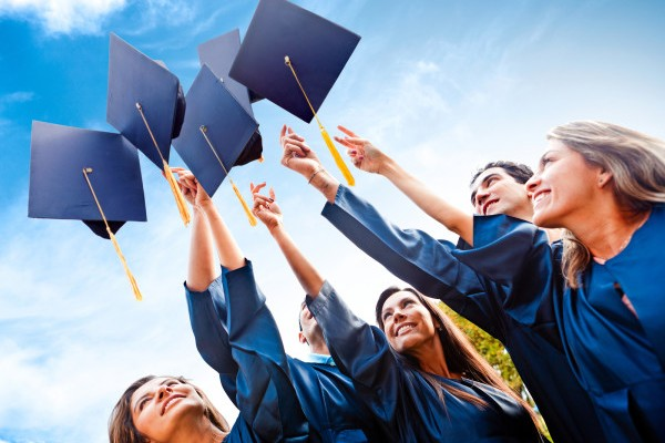 bigstock-Students-throwing-graduation-h-30278906