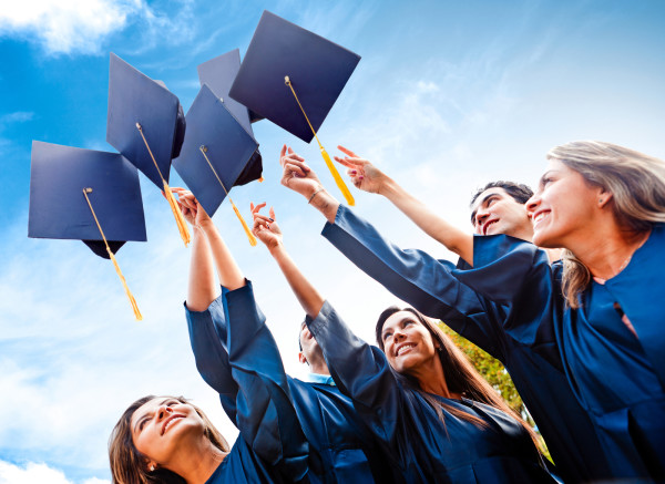 bigstock-Students-throwing-graduation-h-30278906